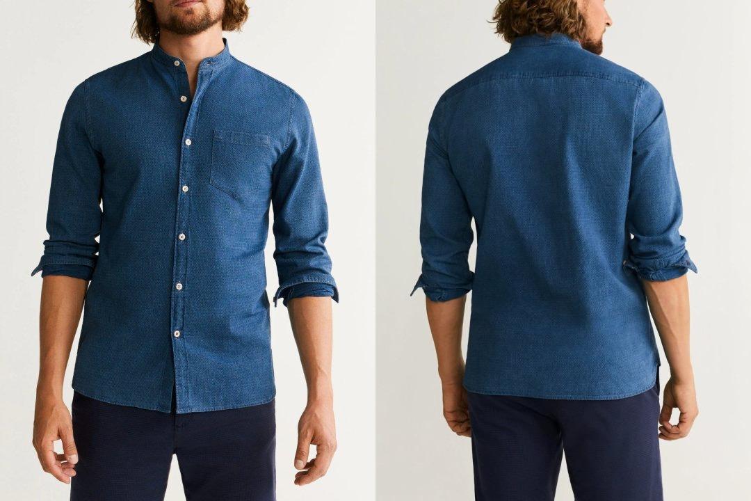 Vyras vilki mėlynus ištrauktus marškinius