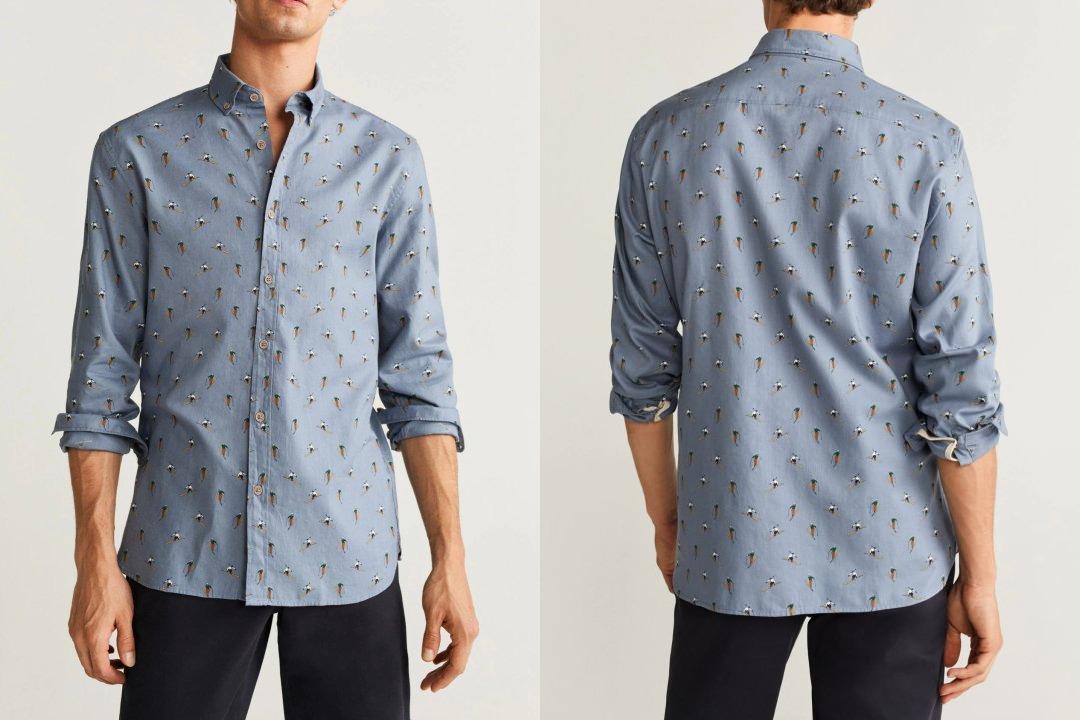 Vyras vilki per ilgus ištrauktus pilkus marškinius