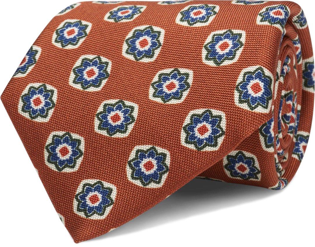 Oranžinis raštuotas kaklaraištis