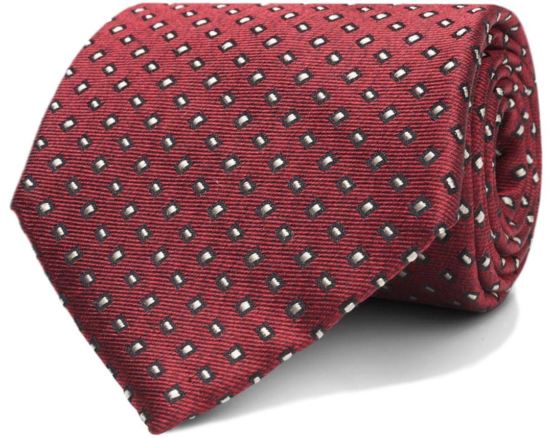 Raudonas taškuotas kaklaraištis