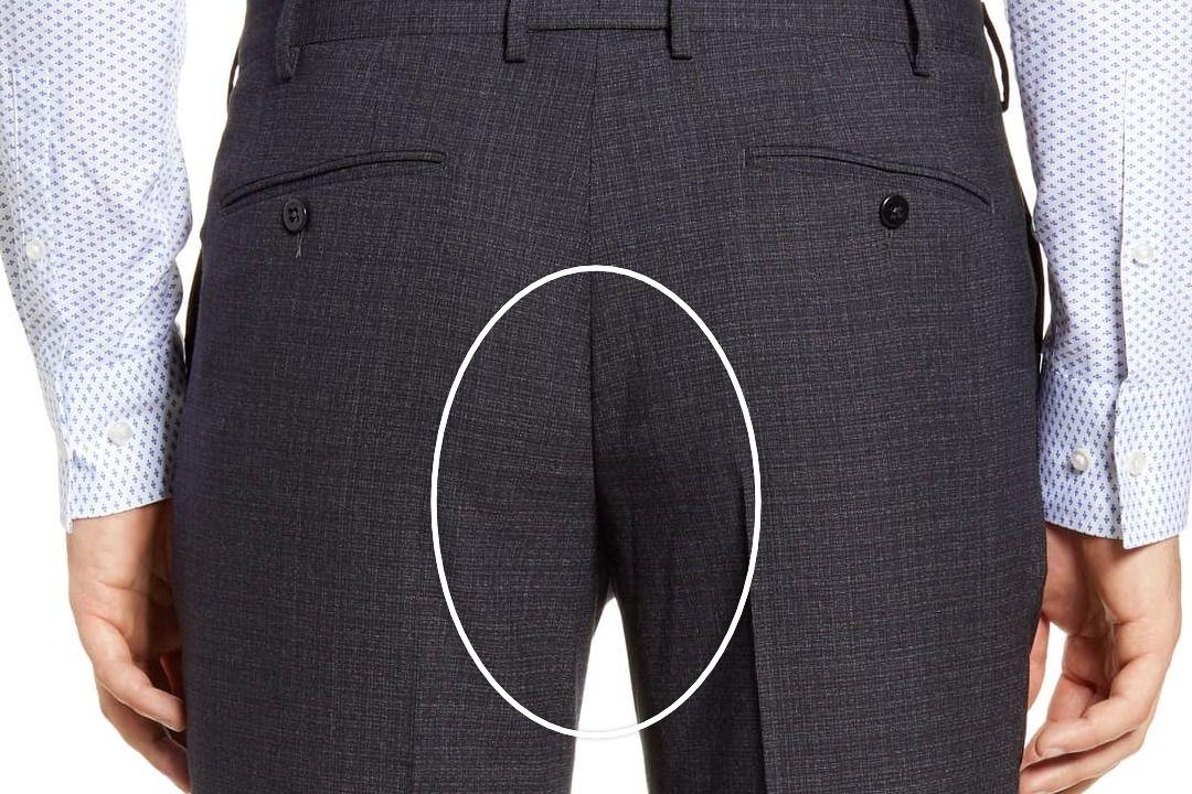 Tamsiai pilkos kostiuminės kelnės iš nugaros