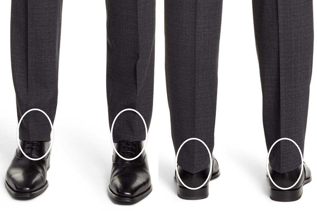 Tamsiai pilkos kostiuminės kelnės juodi batai